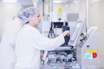 Female working in a medical supply manufacturing enviroment.